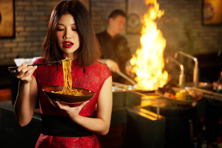 Feast on authentic Chinese food, watch traditional lion dances and play golf with your dog for Chinese New Year 2018