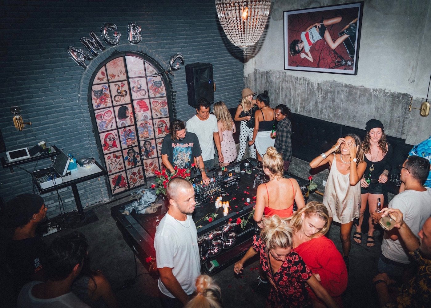 Party-goers at Black Cat Mini Mart - a hidden dive bar in Canggu, Bali, Indonesia