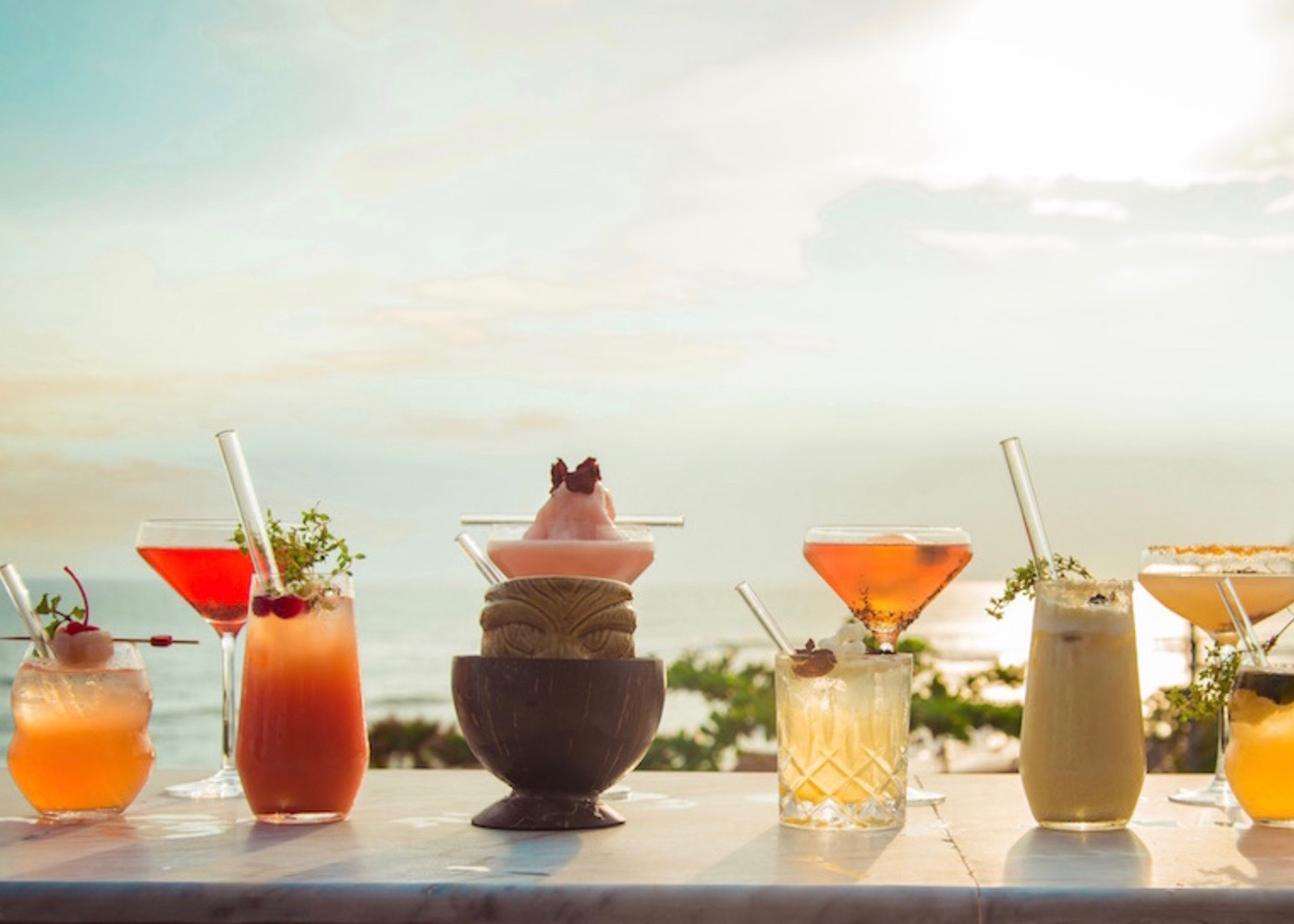 Sunset cocktails overlooking the beach at Ji Terrace by the Sea in Canggu, Bali, Indonesia