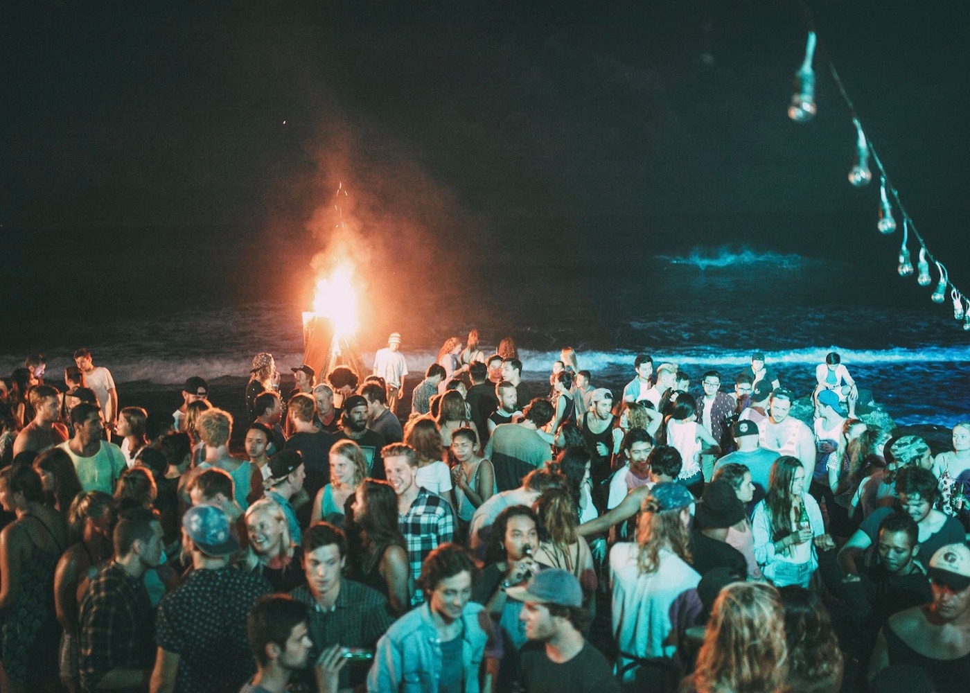 Nighttime beach party at Sand Bar in Canggu, Bali, Indonesia