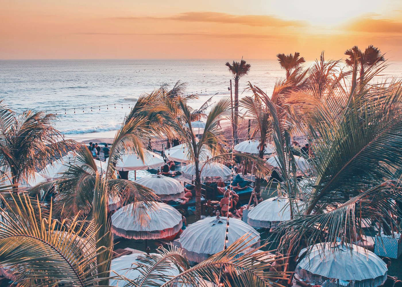 Sunset and ocean views at The Lawn beach club in Canggu, Bali, Indonesia