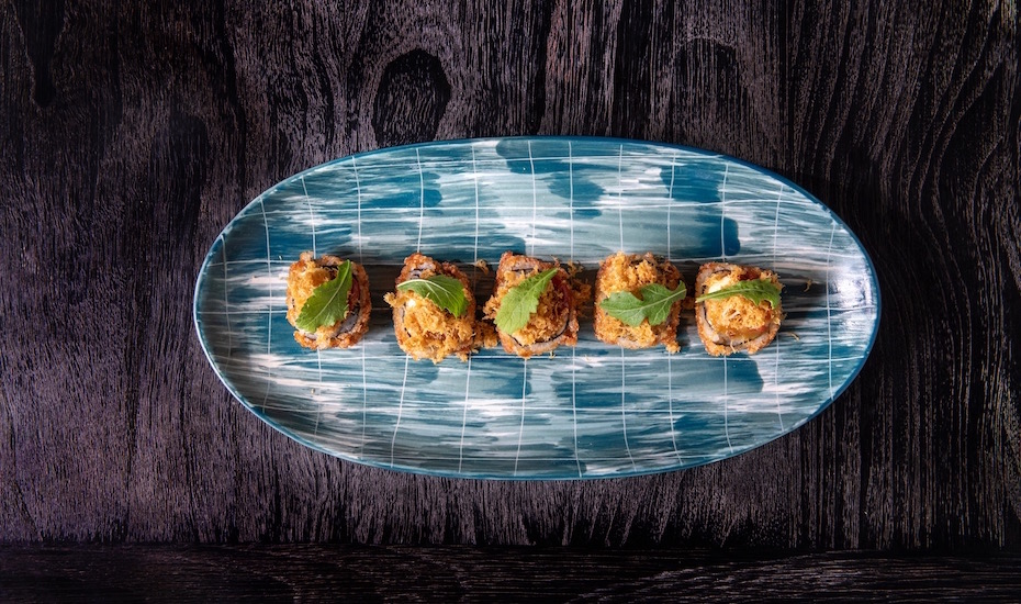 Dine beside the Seminyak seaside at SugarSand for fine Japanese-inspired food, sunset views & cool tunes