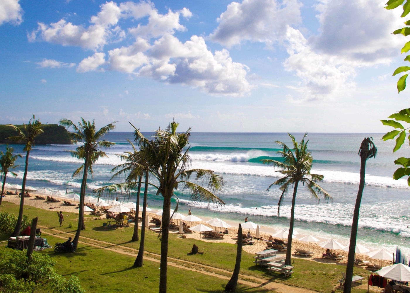 View of the surf, sand and palm trees at Balangan Beach