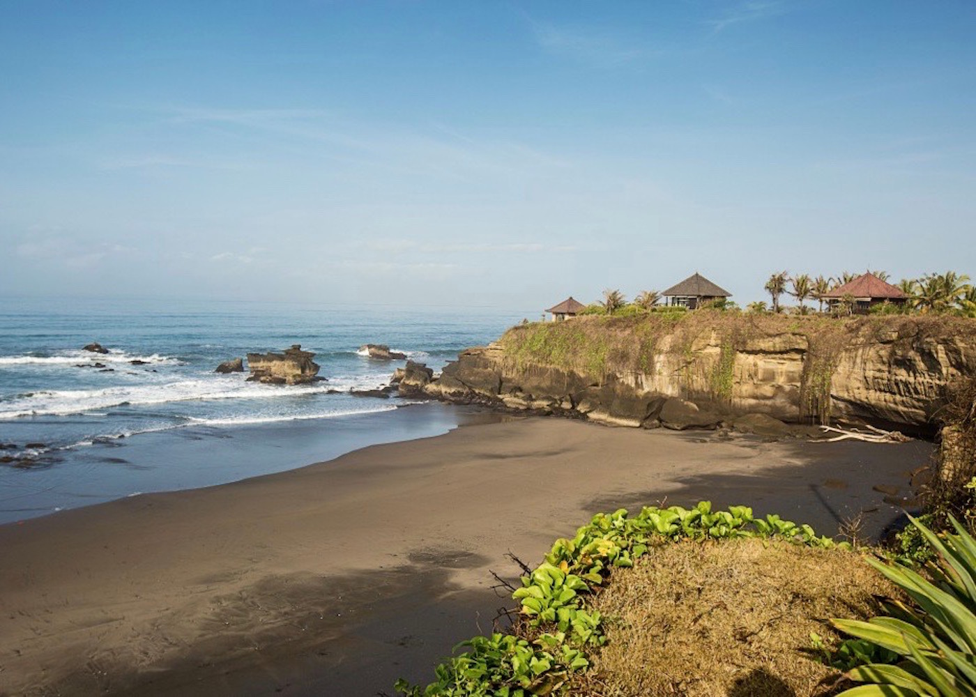 View of the black sands at Balian Beach in Bali, Indonesia