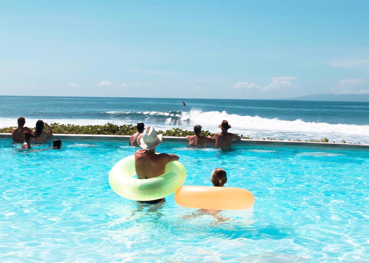 People watching the surf from Komune Beach Club in Keramas, East Bali
