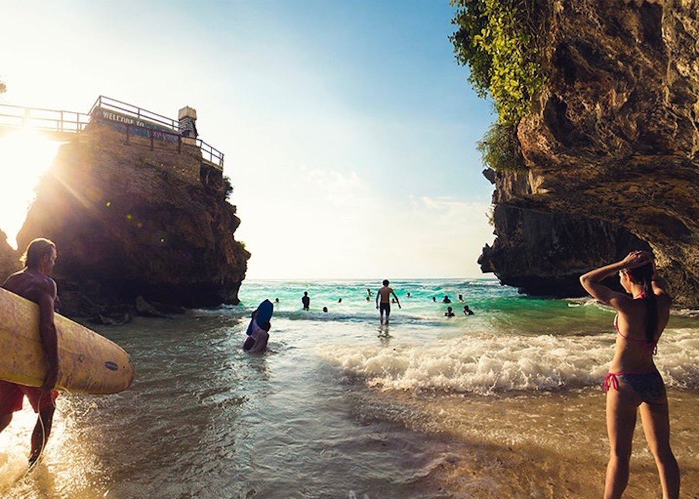 Surfers and beachgoers at Suluban in Uluwatu - one of Bali's best beaches