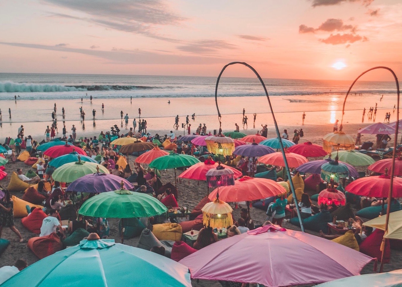 Colourful umbrellas of La Plancha sunset bar on Seminyak Beach in Bali, Indonesia