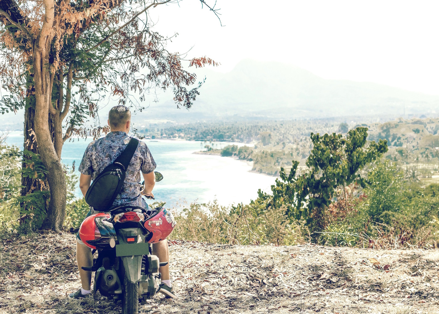 Man riding motorbik on Nusa Lembongan in Bali, Indonesia