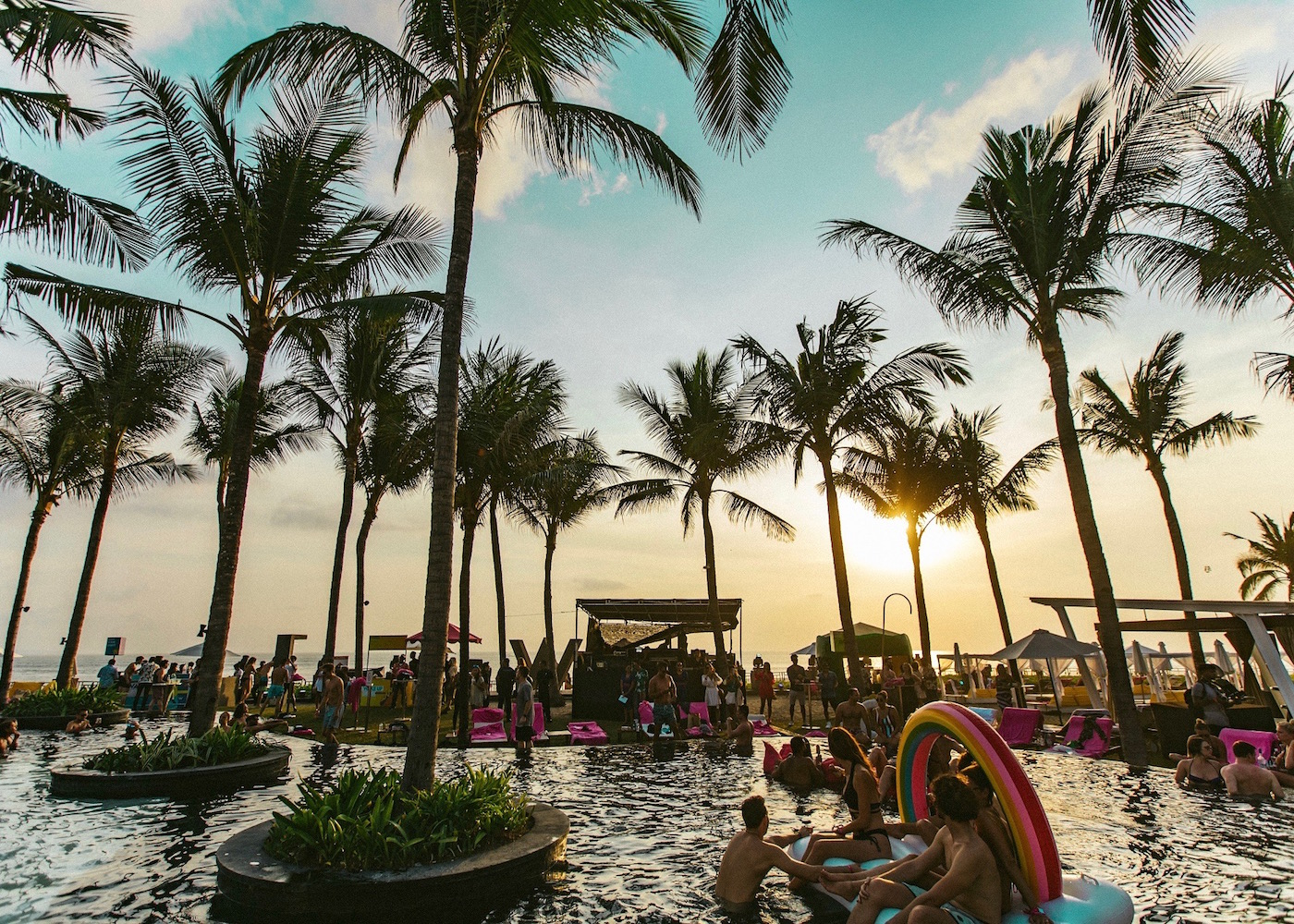 Sunset pool party with floaties at W Bali Seminyak resort