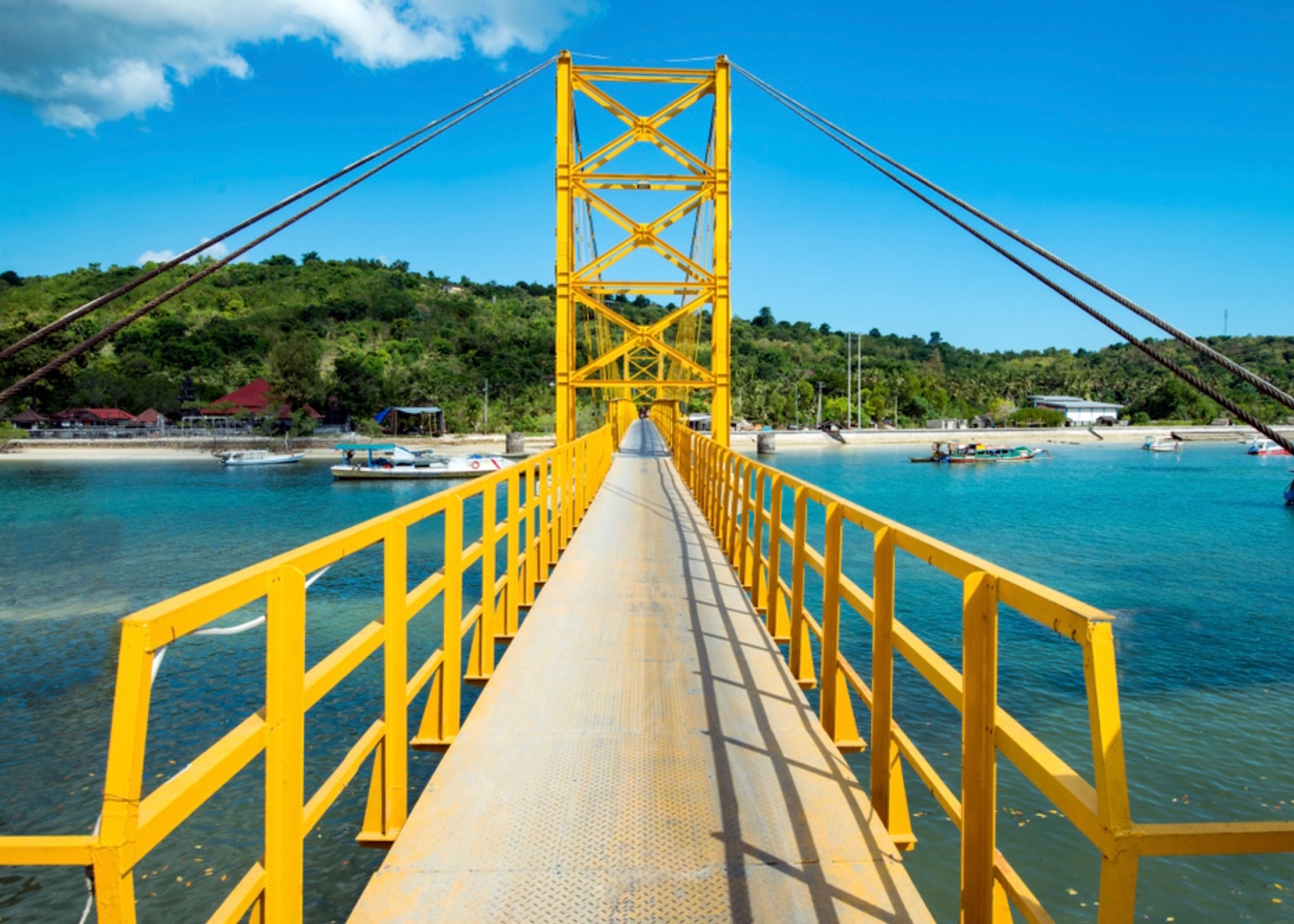 Yellow Suspension Bridge connecting Nusa Lembongan to Nusa Ceningan in Indonesia