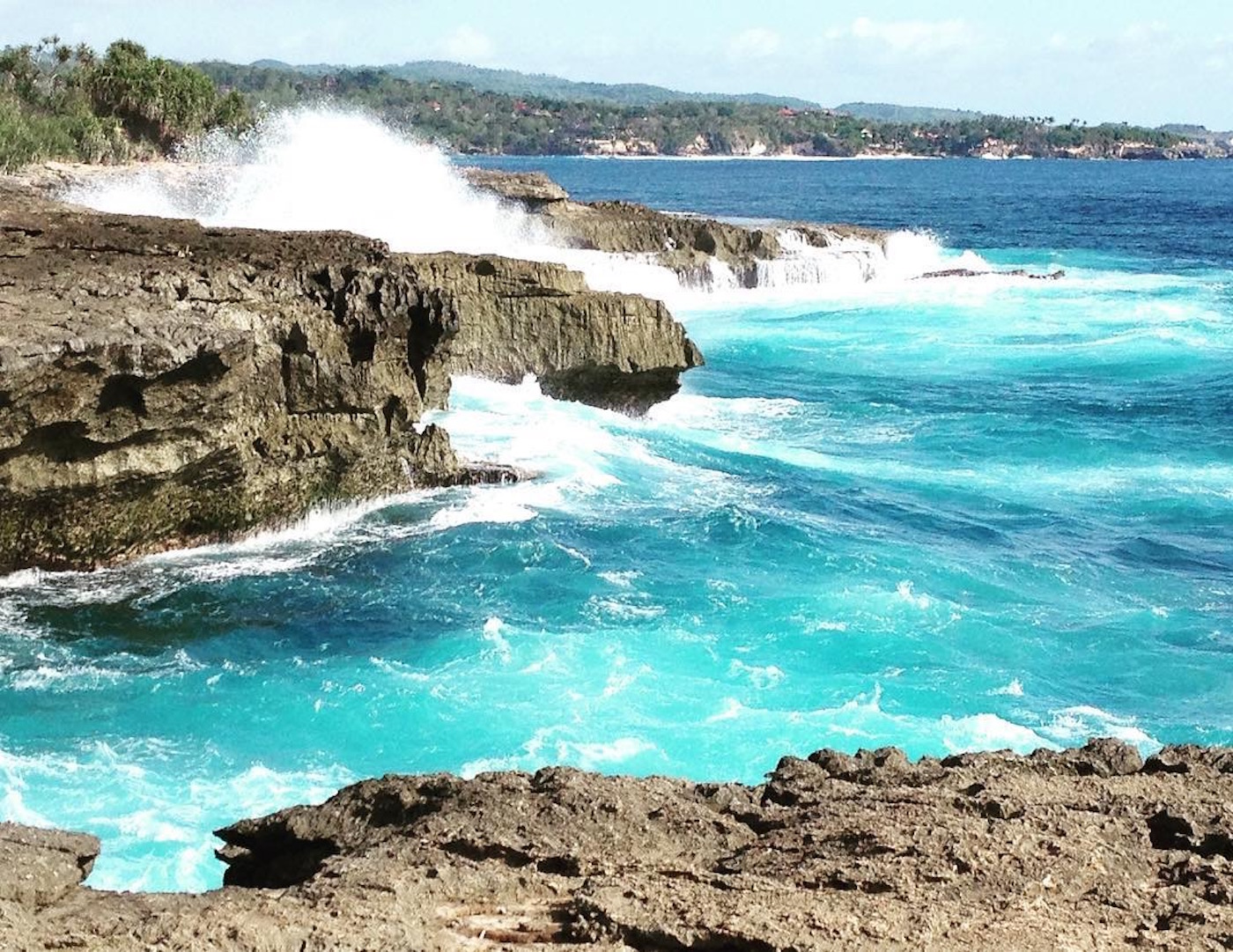Wild ocean meets rugged cliff at Devil's Tear on Nusa Lembongan in Bali, Indonesia