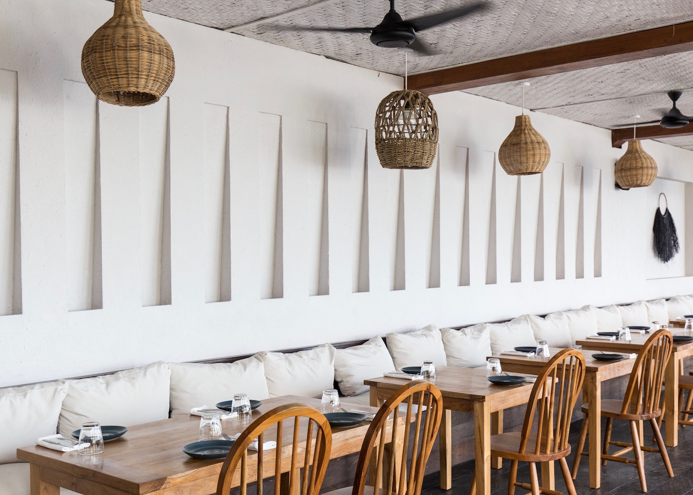 White interiors using local materials at The Lawn beach club in Canggu, Bali, Indonesia