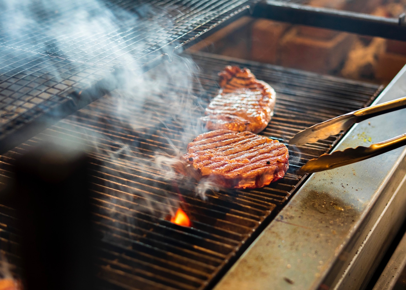 Steak cooking on a grill at SugarSand in Seminyak, Bali, Indonesia