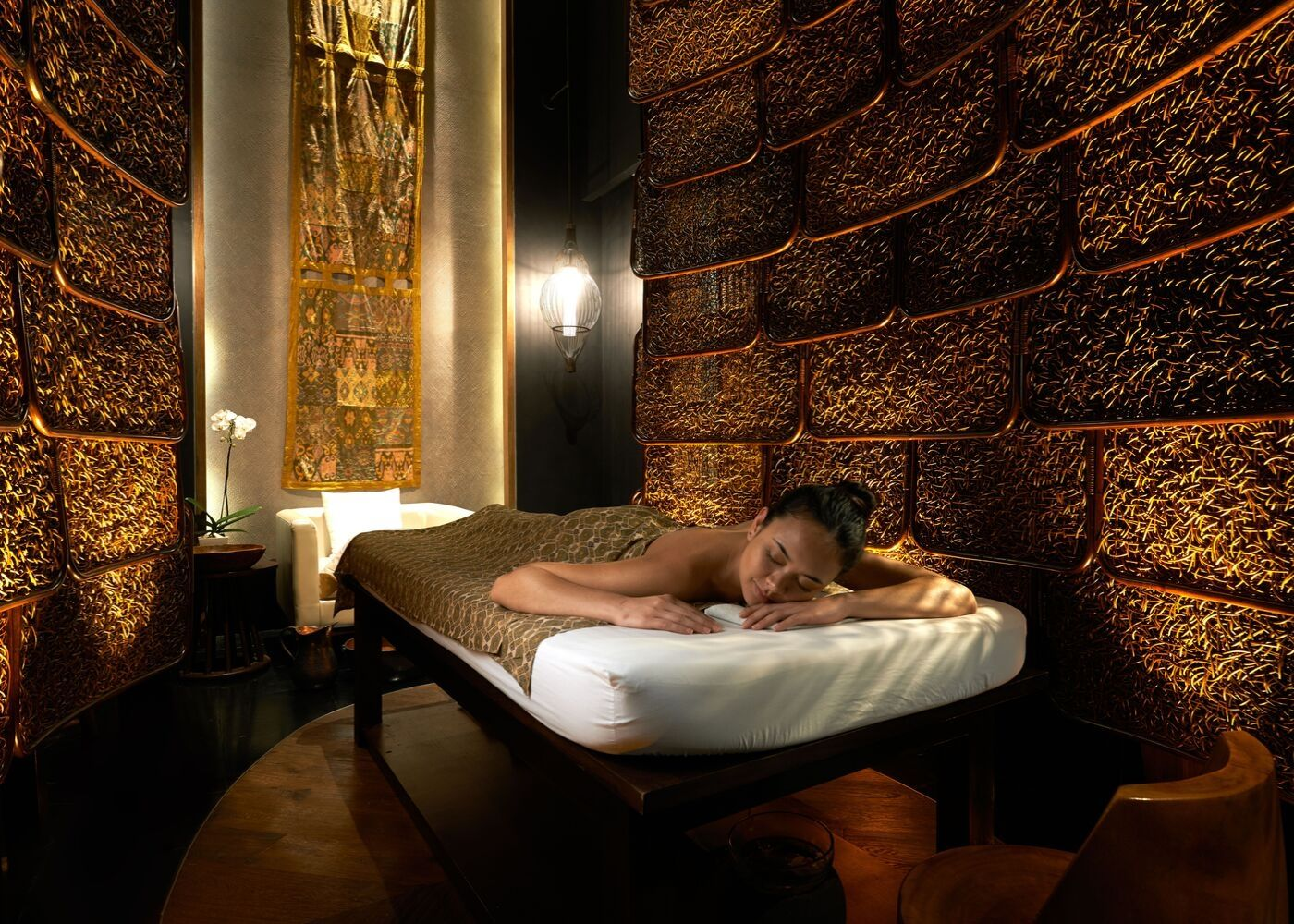 A woman enjoying spa treatments at Sofitel Bali Nusa Dua Beach Resort