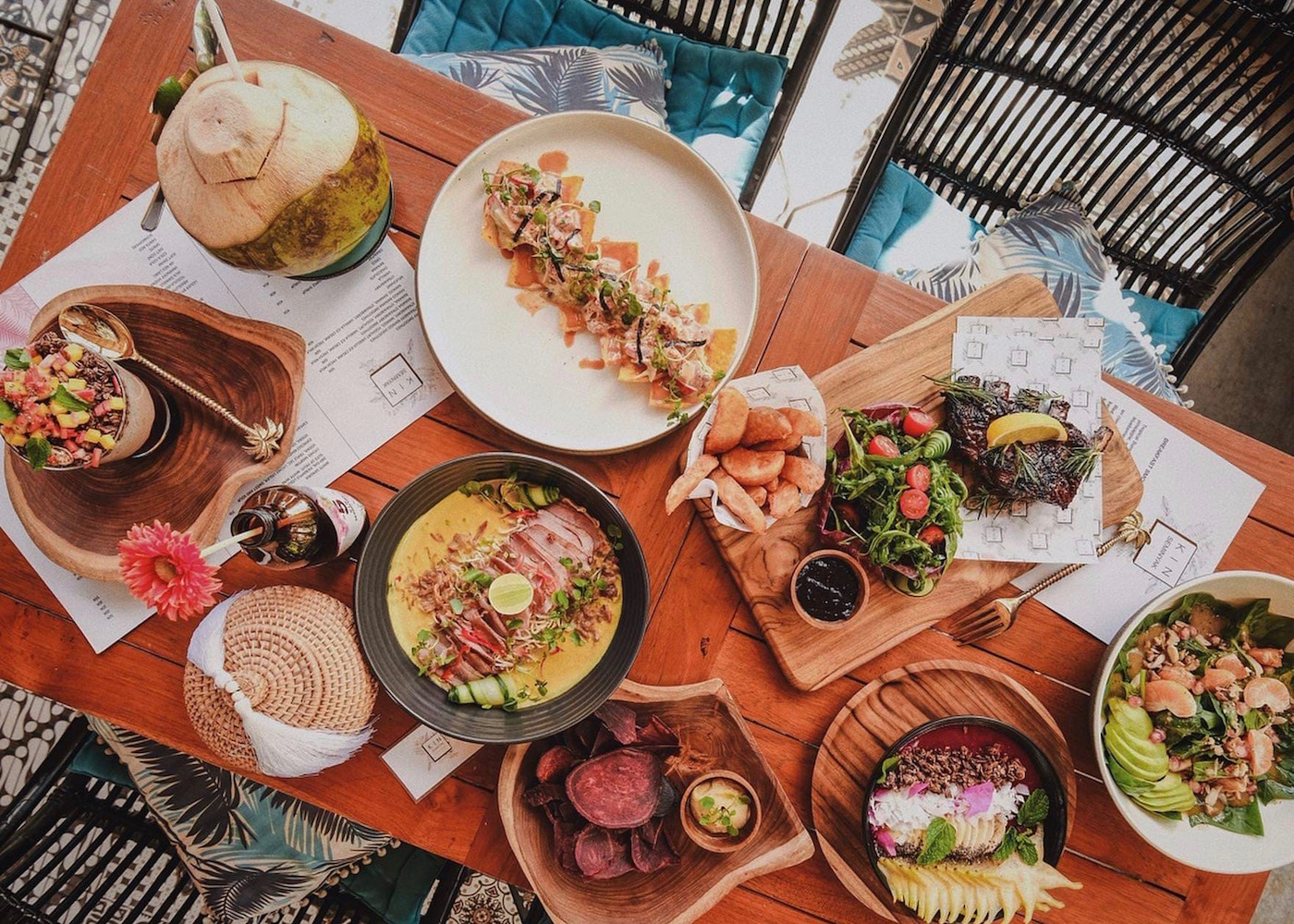 Food spread at KIN Seminyak - an all-day cafe and restaurant in Bali, Indonesia