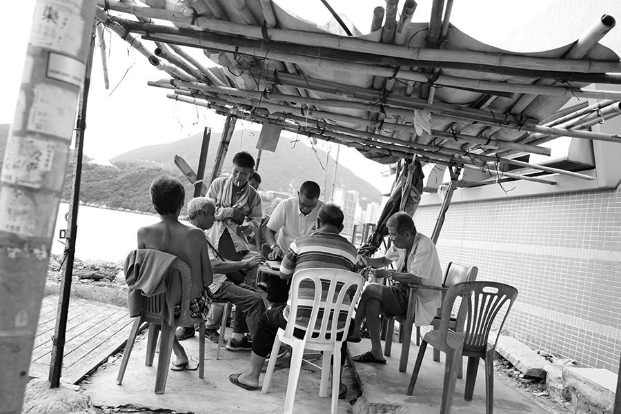 black and white photography Hong Kong pocket gamers in Lei Yue Mun Park