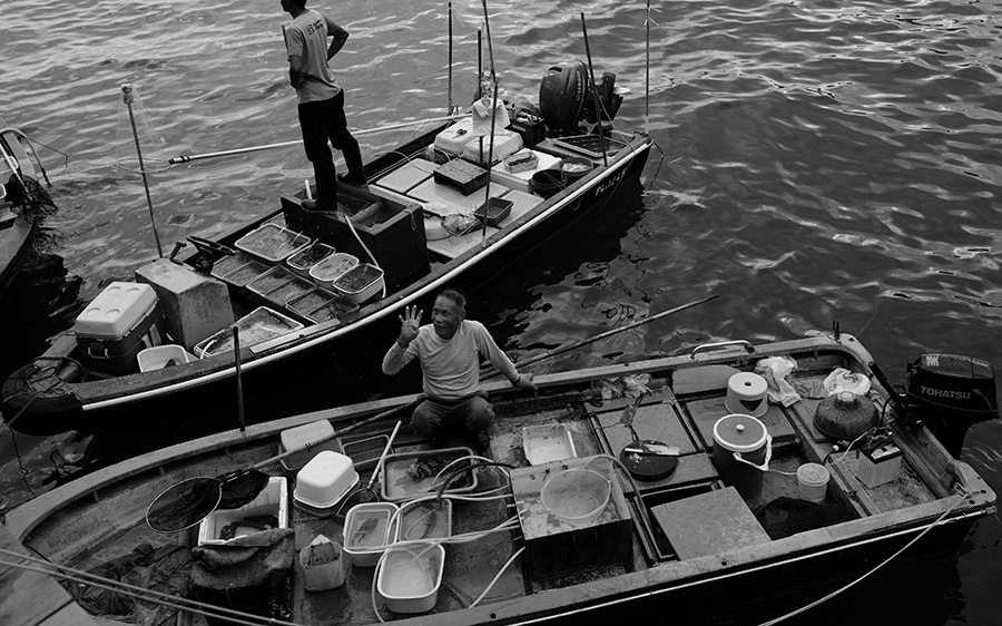 black and white photography Sai Kung Pier floating fish market