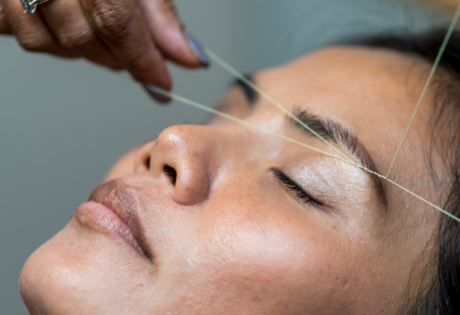 eyebrow threading in hong kong woman having eyebrows threaded