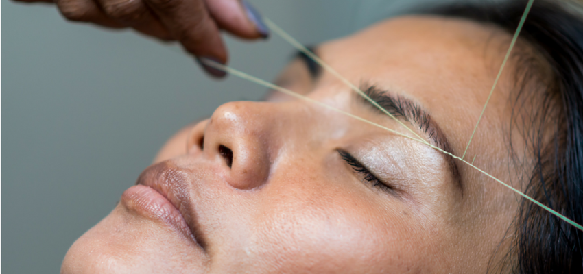 eyebrow threading in hong kong woman having eyebrows threaded