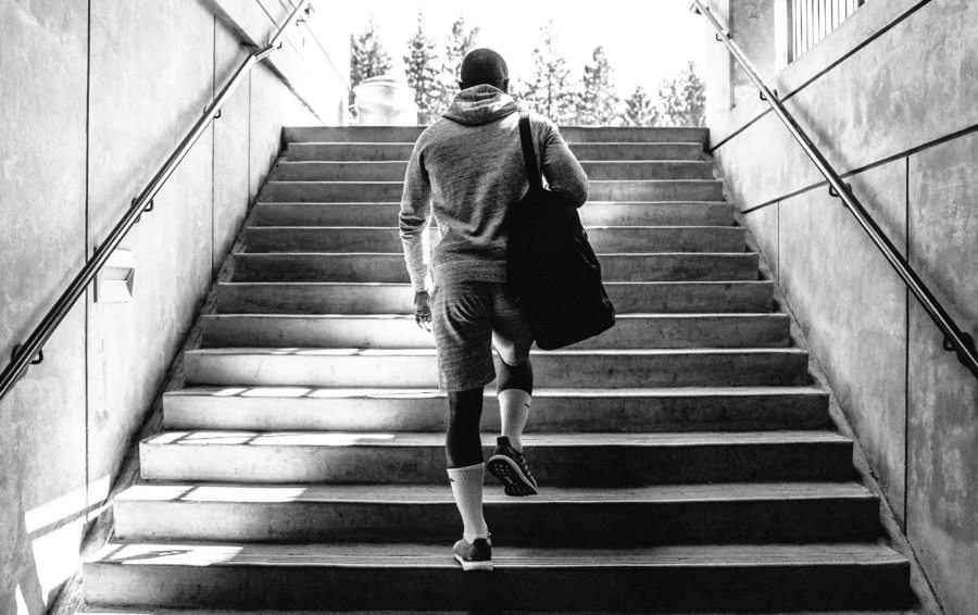 men's activewear in hong kong man walking up stairs