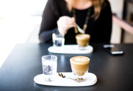 new cafes in Hong kong May woman drinking coffee