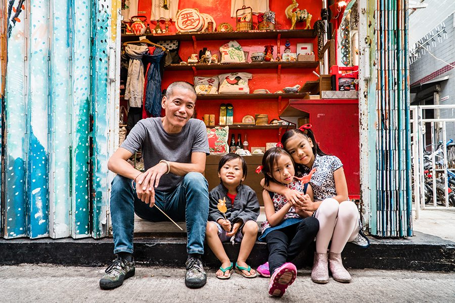 sugarman louis to and family in front of his cheung chau store