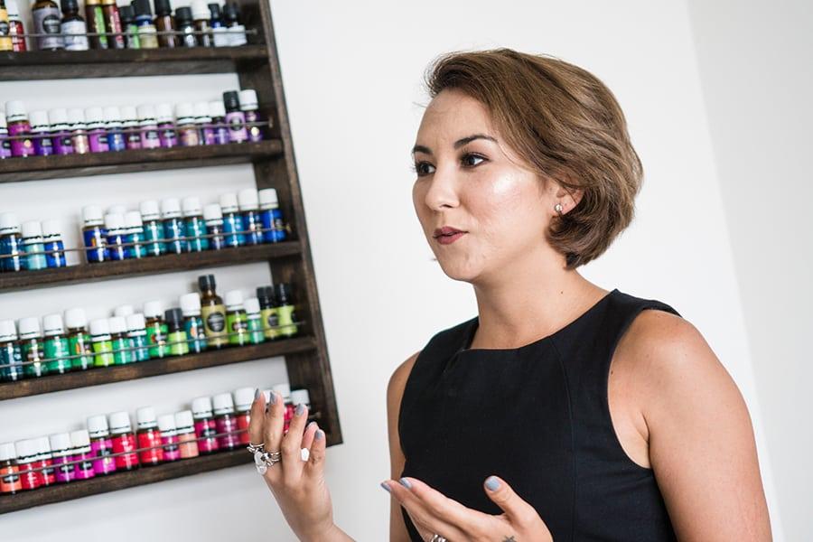 Coco Chan explaining aromatherapy oils