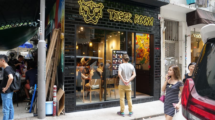 tiger room exterior man standing outside