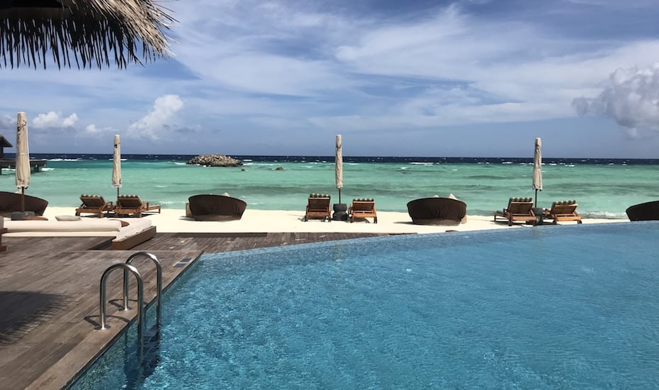 The main pool at The Residence Maldives overlooks the white sand beach.
