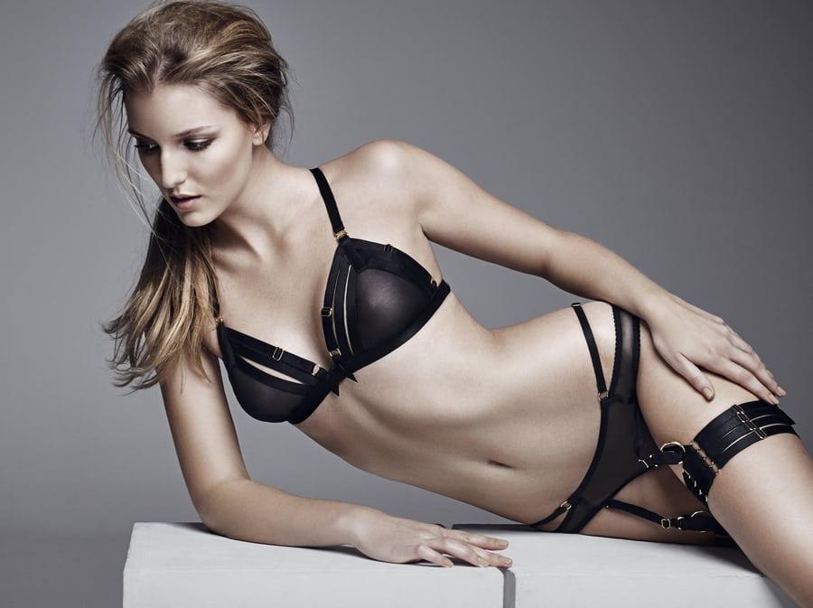 avec amour bordelle uk brand girl on side with black lingerie
