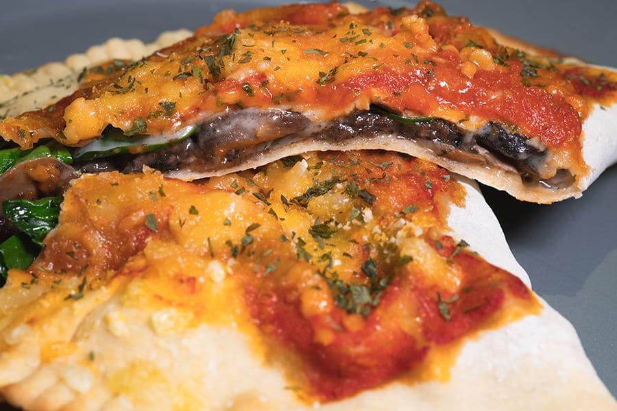 POP Vegan vegetarian restaurants in Central Truffle Mushroom Spinach Calzone