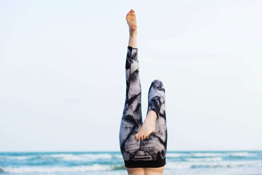 wellness events in Asia 2019 woman doing handstand