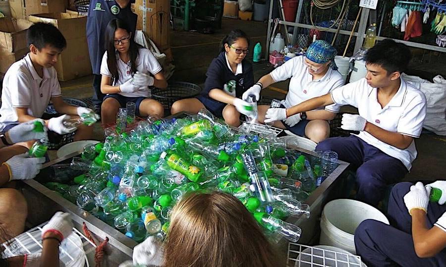 HK Recycles volunteer with kids in Hong Kong