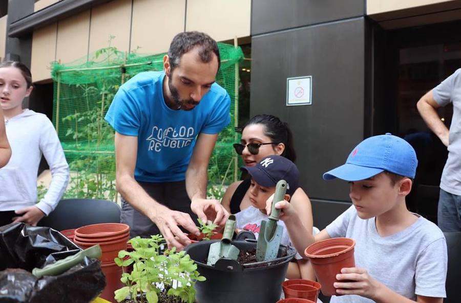 Rooftop Republic Urban Farming volunteers with kids in Hong Kong