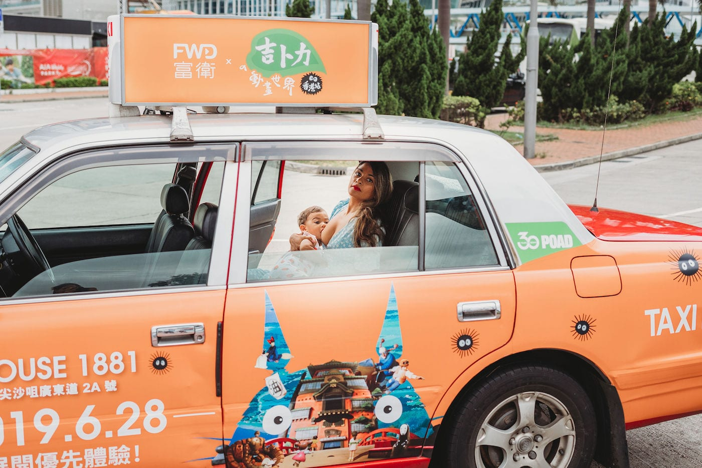 woman breastfeeding in taxi