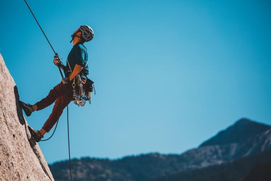 person climbing uphill