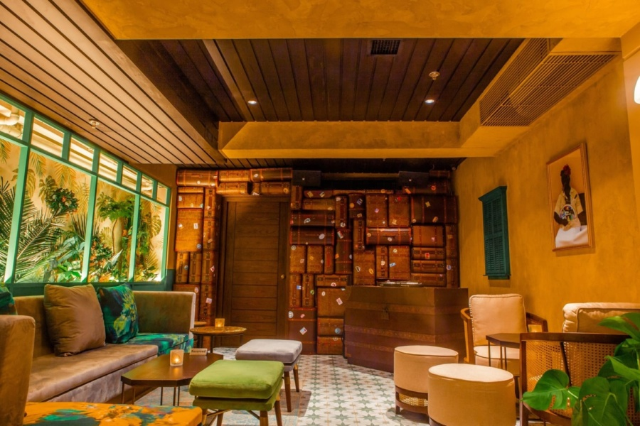 a space with warm lighting and Cuban paintings