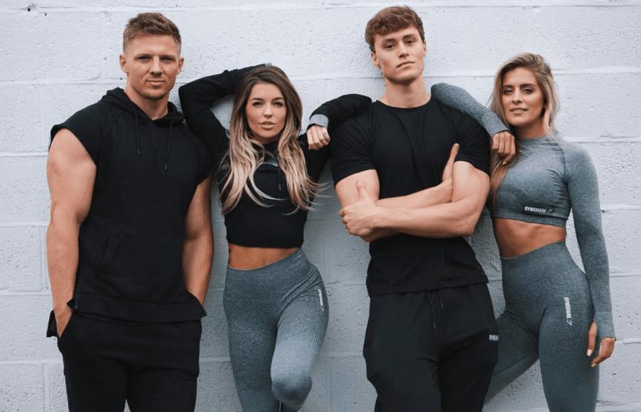 4 people wearing grey sportswear